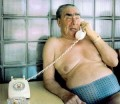 Photo of Leonid Brezhnev, in trunks and with telephone
