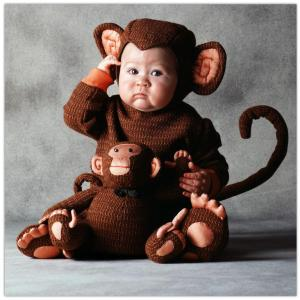 monkey kid with monkey stuffed animal