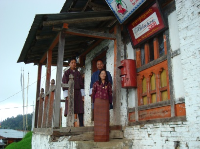 Postmistress in front of Wamrong Post Office in east Bhutan, July 2008