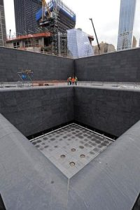 employees-of-4-js-associates-lead-a-tour-of-the-world-trade-center-site-to-view-plumbing-work-for-the-fountains